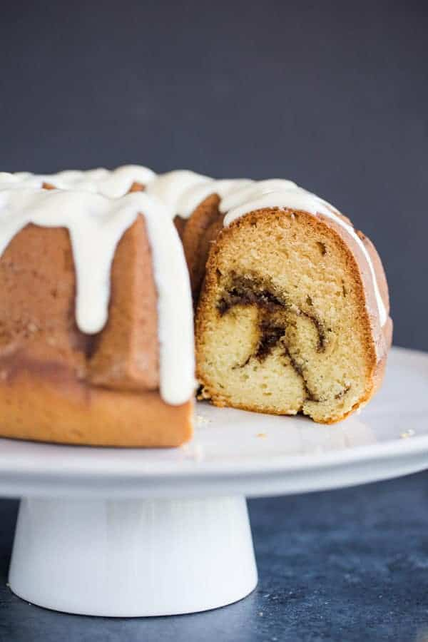 A beautiful bundt coffee cake with cinnamon swirls and cream cheese icing.