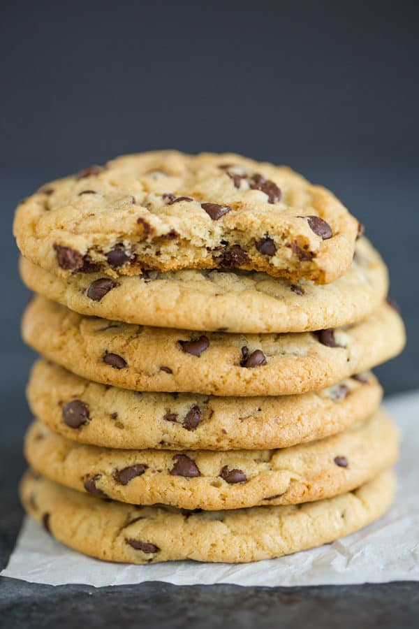A big stack of soft and chewy chocolate chip cookies.