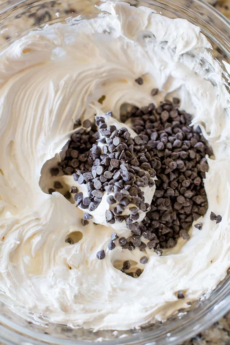 Perfectly whipped up meringue with chocolate chips ready to be stirred in.