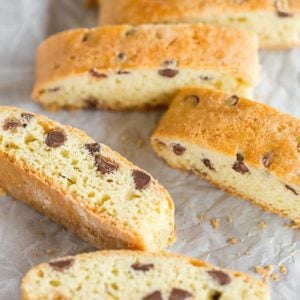 Soft biscotti sliced and laying on parchment paper.