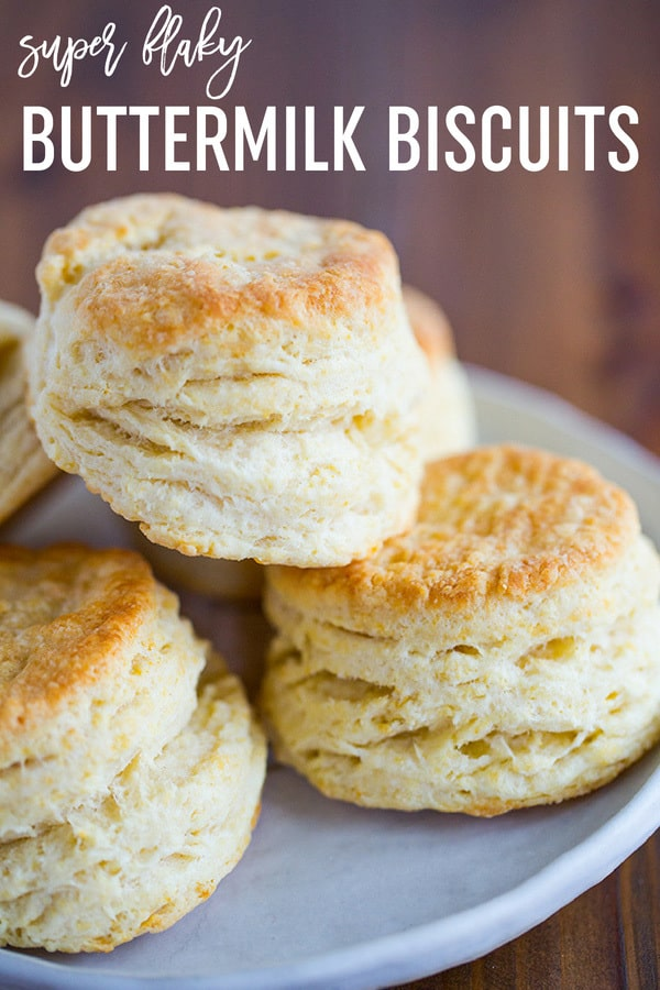 Easy Buttermilk Biscuits! Made from scratch, tall, fluffy and flaky biscuits with just one simple trick. Eat them on their own, with a smear of butter, or use as a base for sausage gravy, strawberry shortcake, or your favorite breakfast sandwich. #breakfast #brunch #biscuits #homemade #fromscratch