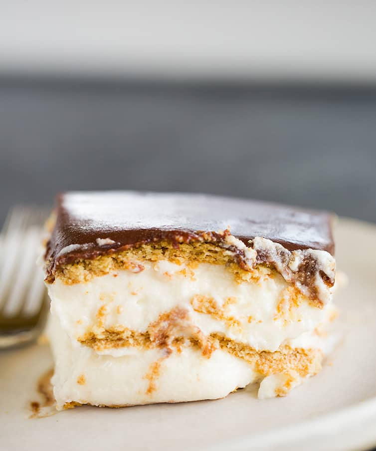 A piece of Chocolate Eclair Cake on a plate.