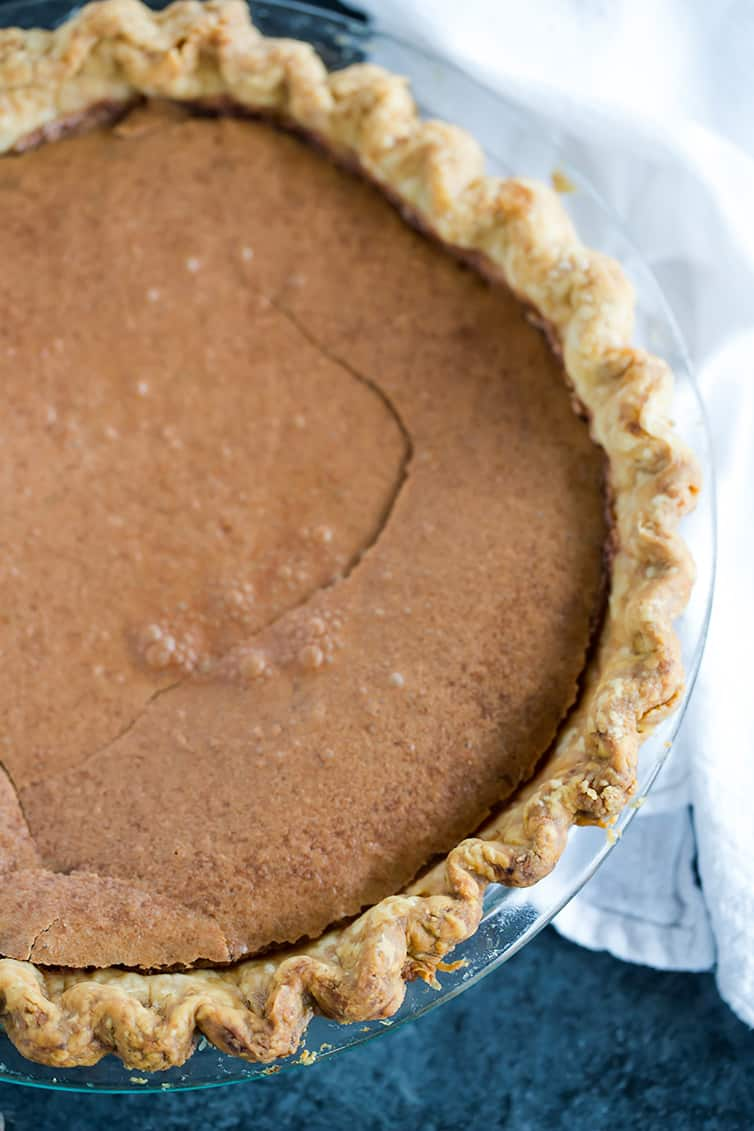 An overhead view of a baked chocolate chess pie.