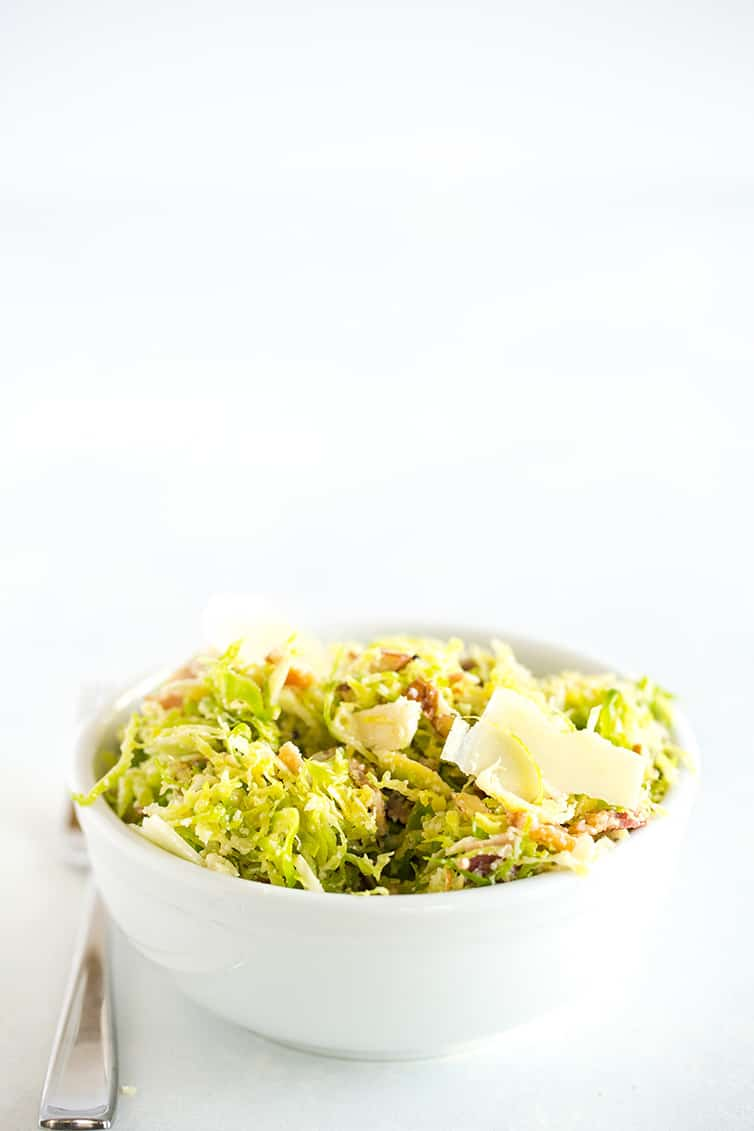 A white bowl with Brussels sprouts salad.