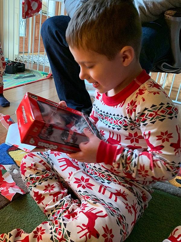 Joseph opening a present.