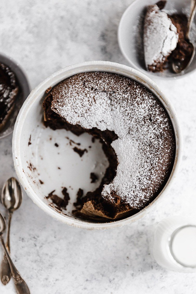 An overhead shot of chocolate souffle half eaten.