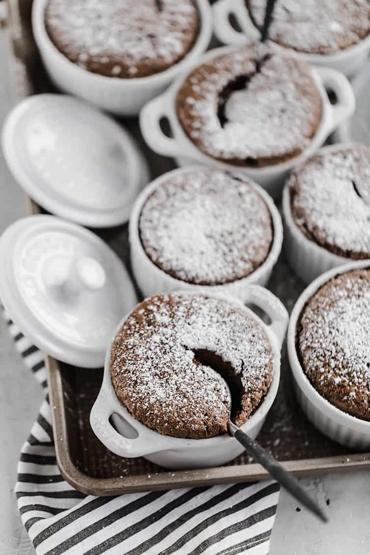 Individual chocolate souffles in ramekins.