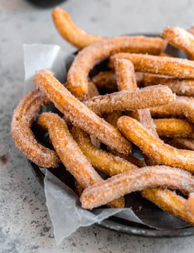 A platter piled high with churros.