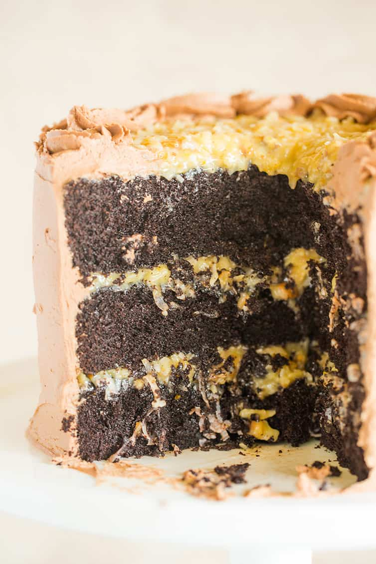 The inside of a German chocolate cake that has had slices removed.