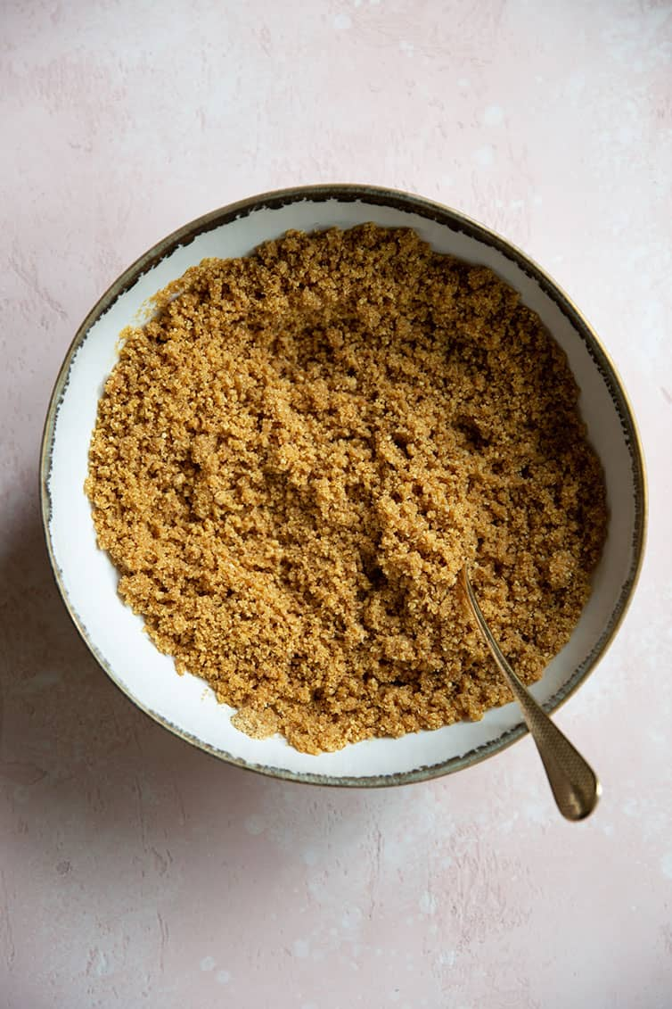 Graham cracker crust mixed together in a bowl.