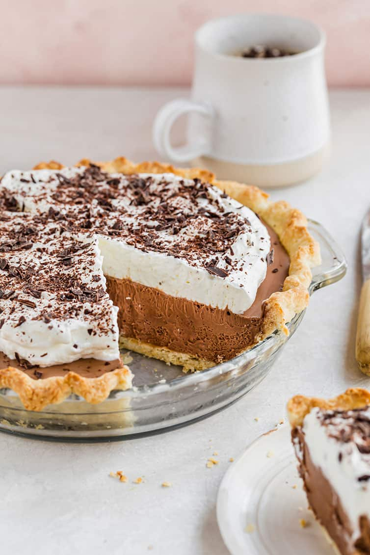 A French silk pie with a slice taken out.