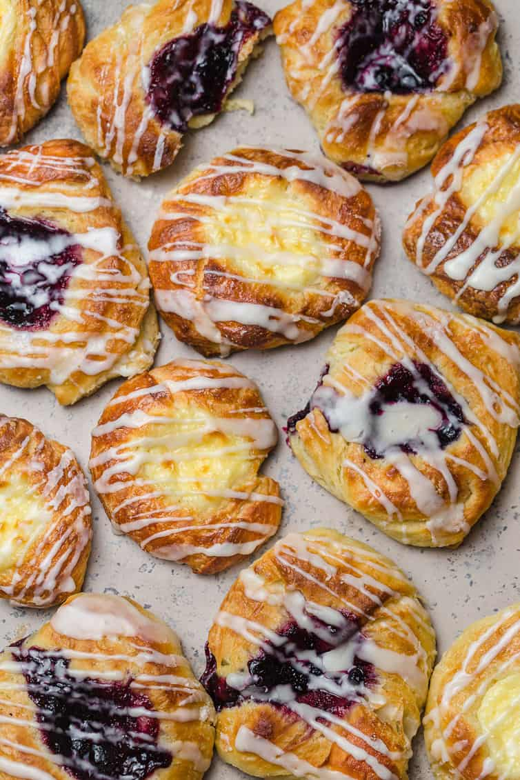 An overhead photo of cheese and fruit danishes.