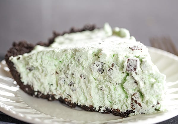 A slice of mint chocolate chip pie on a plate.