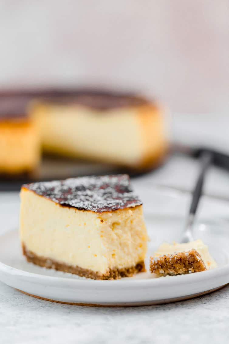 Slice of cheesecake on a plate with a fork.