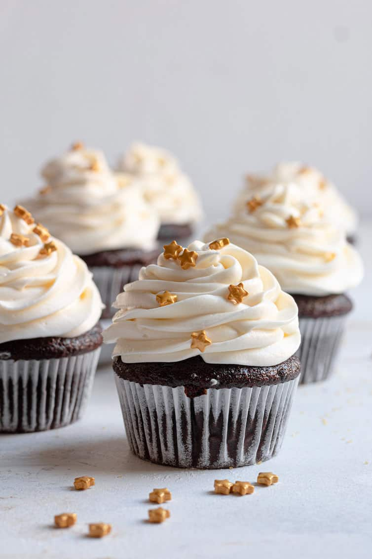 Chocolate cupcakes topped with cream cheese frosting.