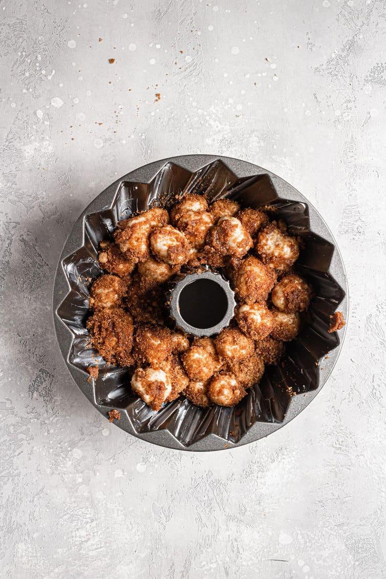 Monkey bread dough in a Bundt pan before rising.