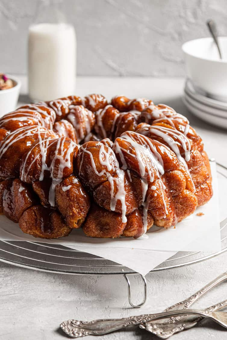 Monkey bread on parchment paper on a cooling rack.