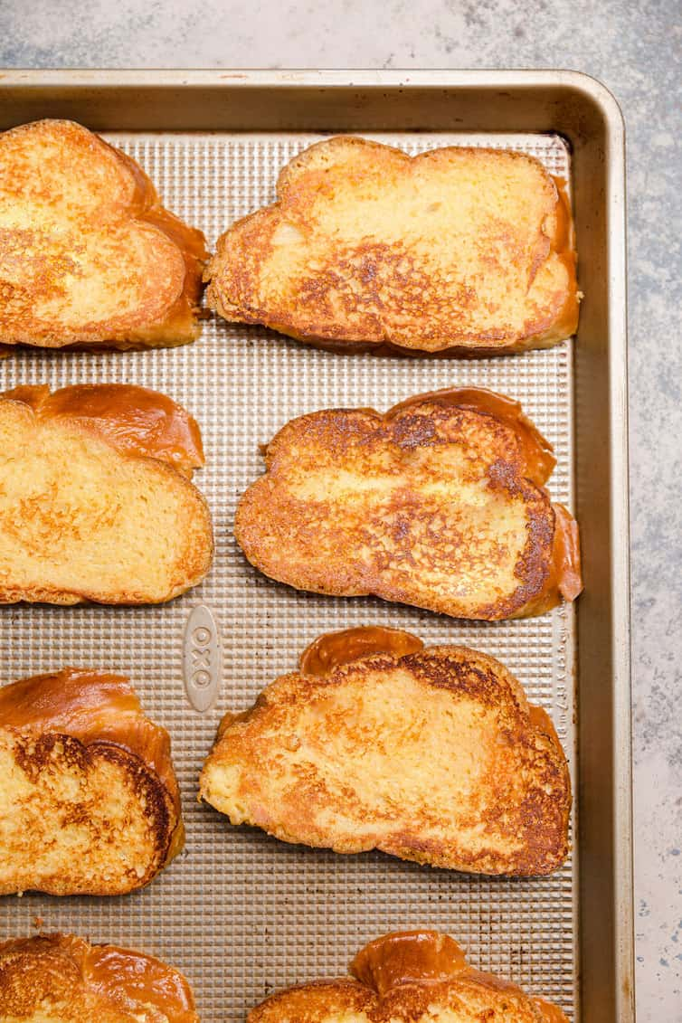 Cooked French toast on a baking pan.