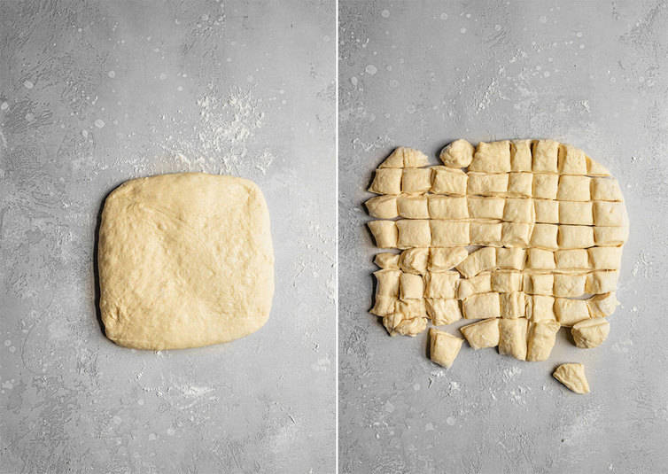 Monkey bread dough in a rectangle, cut into small squares.