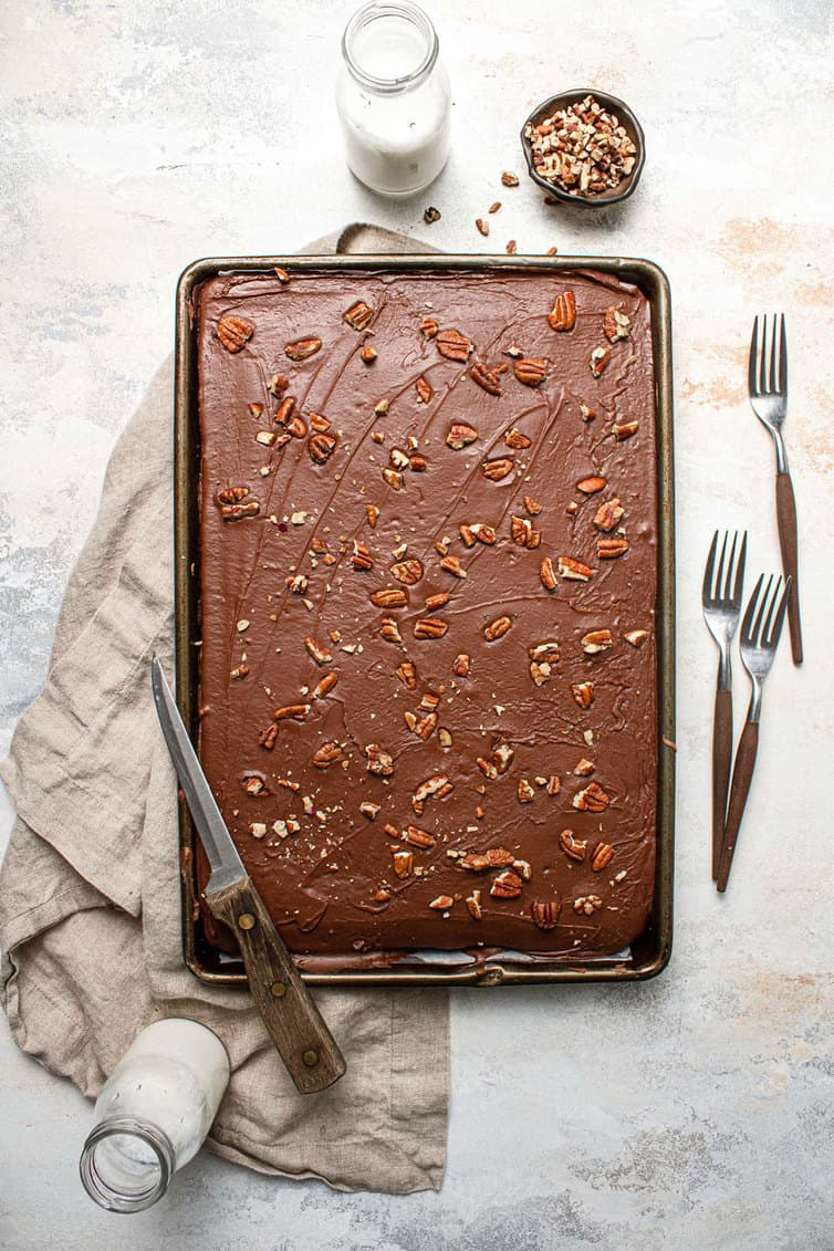 A pan of chocolate Texas sheet cake with pecans.