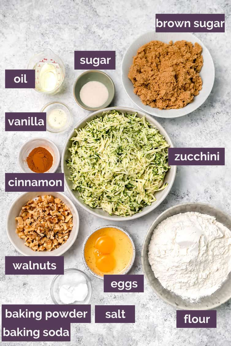 Ingredients for zucchini bread prepped in bowls on counter.