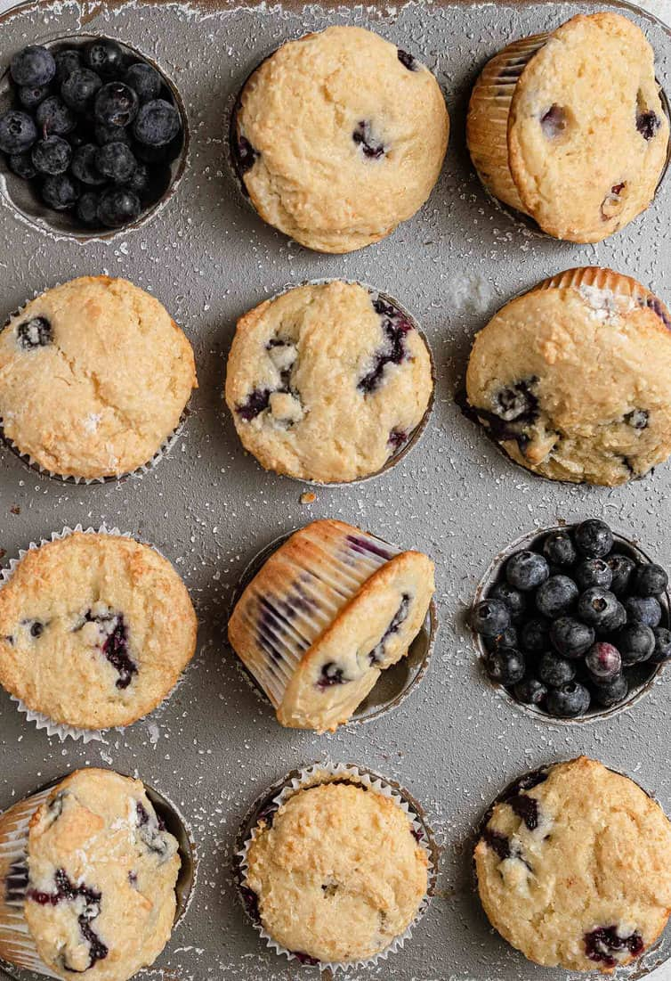 Baked blueberry muffins in a muffin pan.