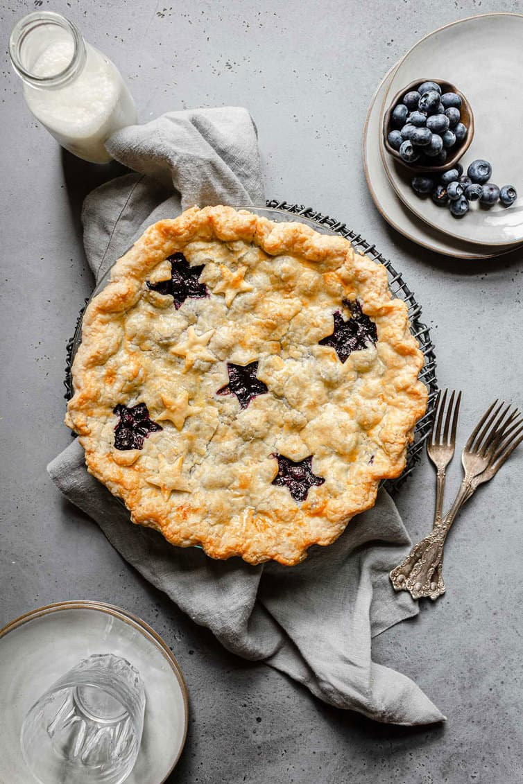 Overhead photo of whole baked blueberry pie.