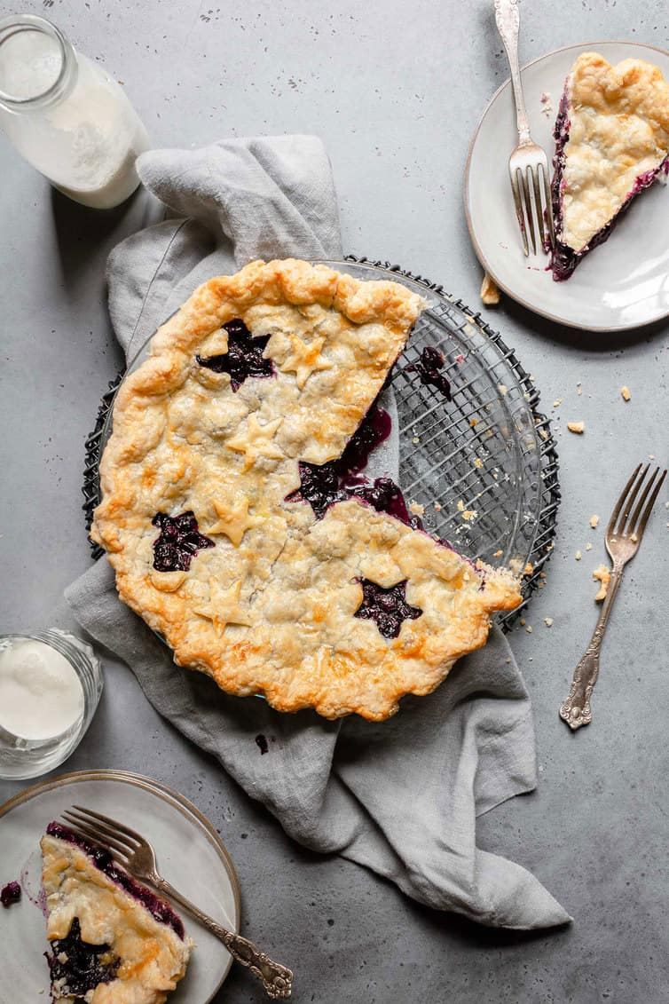 Blueberry pie with two slices removed.