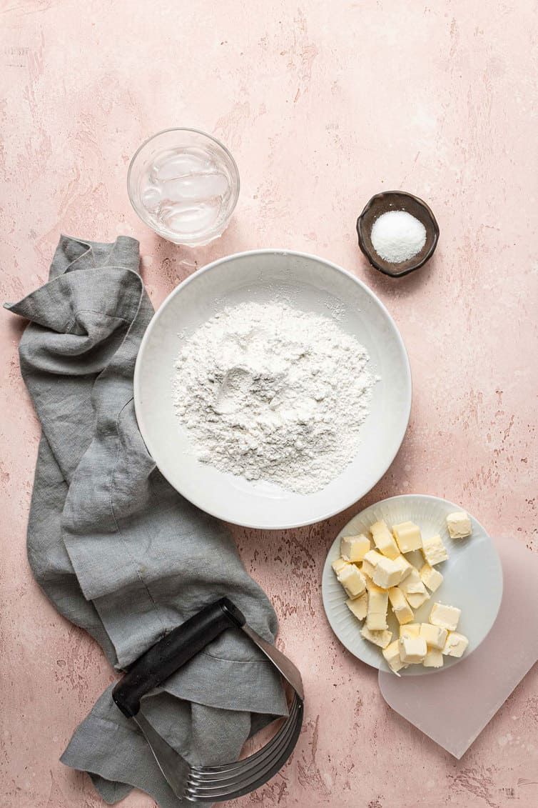Butter pie crust ingredients prepped in bowls.