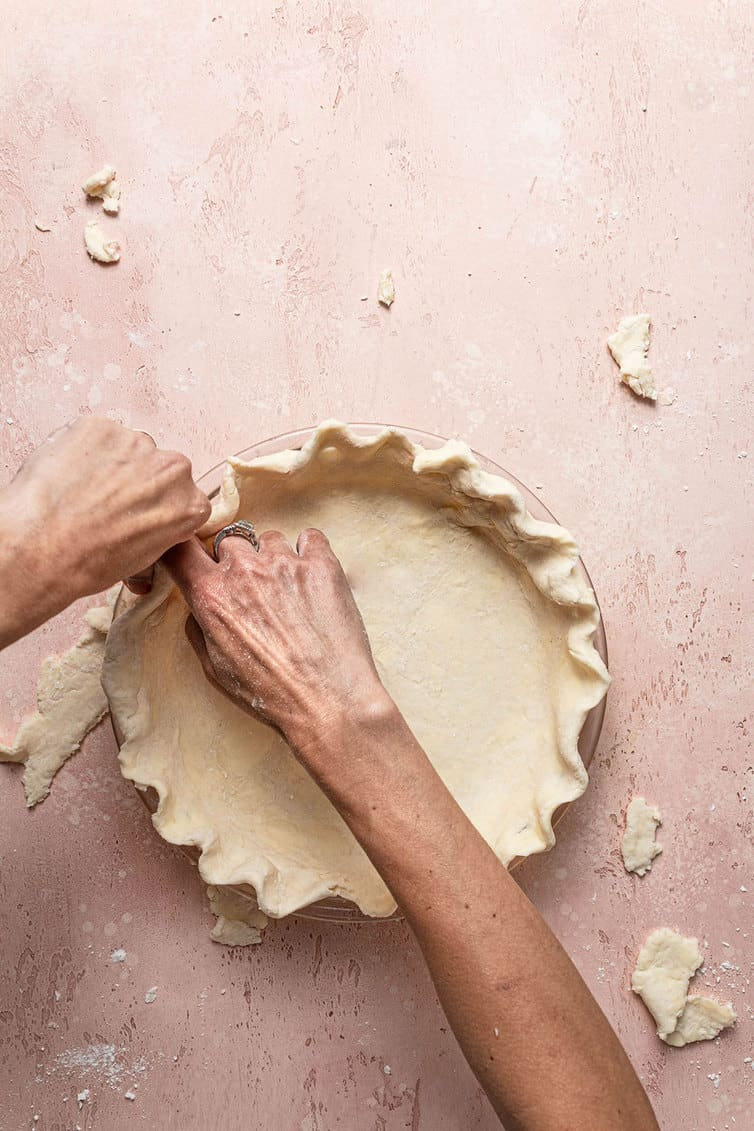 Crimping butter pie crust.
