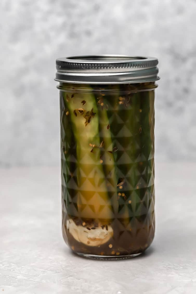 A jar of dill sandwich pickles.