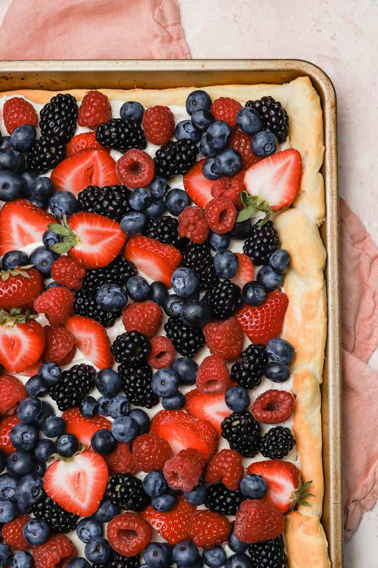 Fruit pizza topped with fresh berries.
