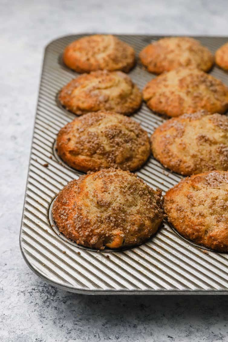 Baked apple muffins still in pan.
