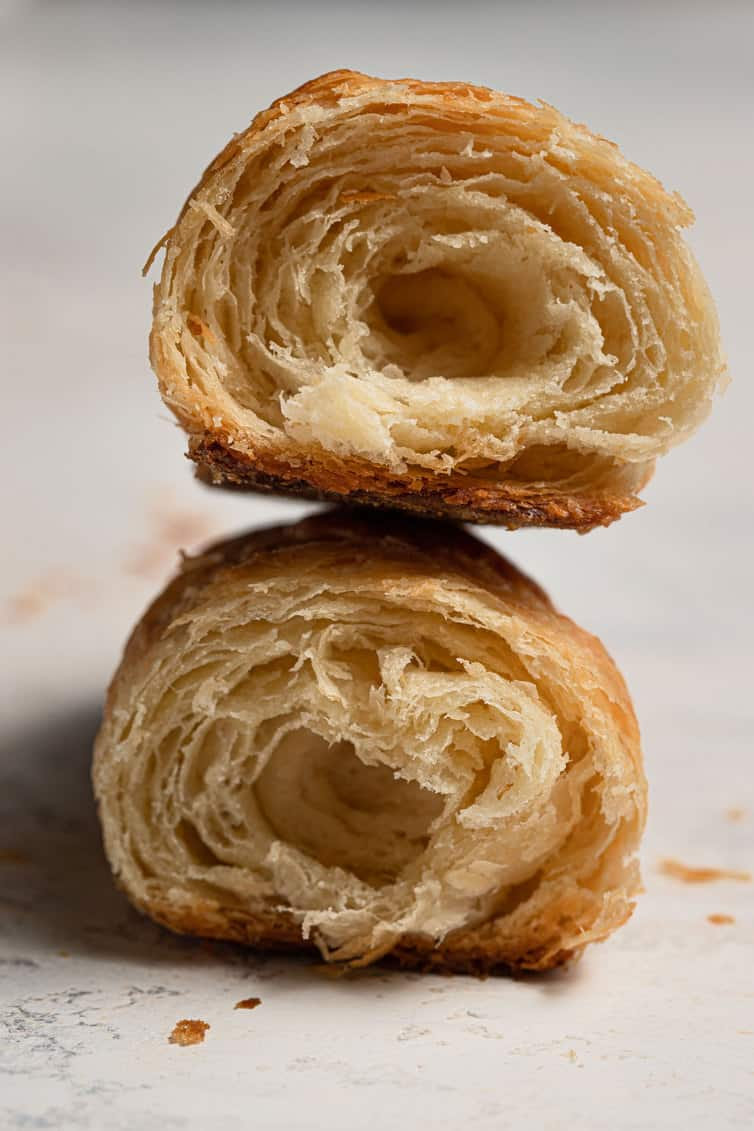 Two halves of a croissant stacked on top of each other.