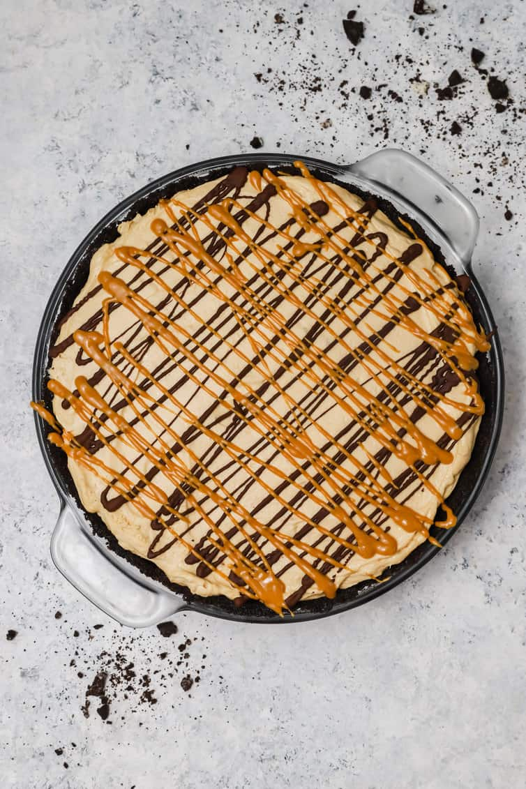 Overhead photo of peanut butter pie drizzled with peanut butter and chocolate.