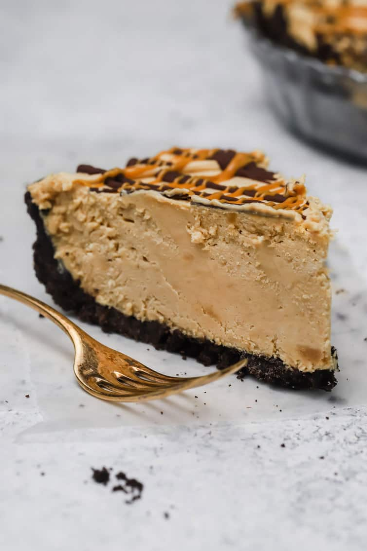 A single slice of peanut butter pie with a fork.