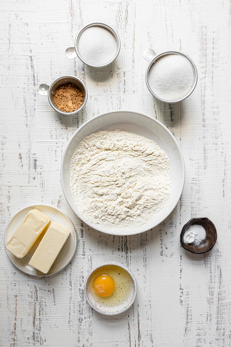 Ingredients for sugar cookies prepped in bowls.