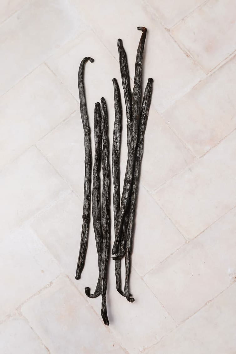 Whole vanilla beans on the counter.
