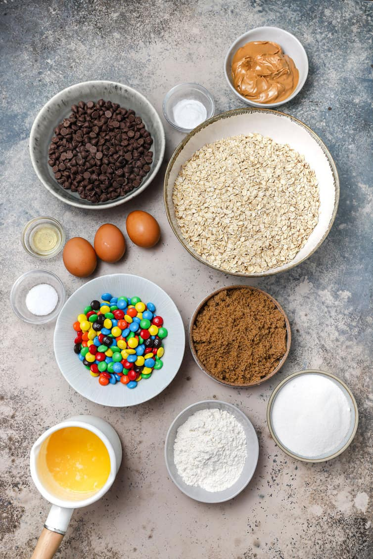 Ingredients for monster cookies prepped in bowls.