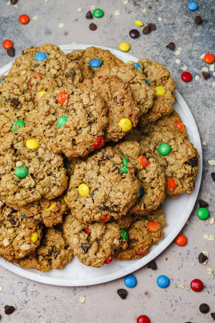 A white plate piled high with monster cookies.