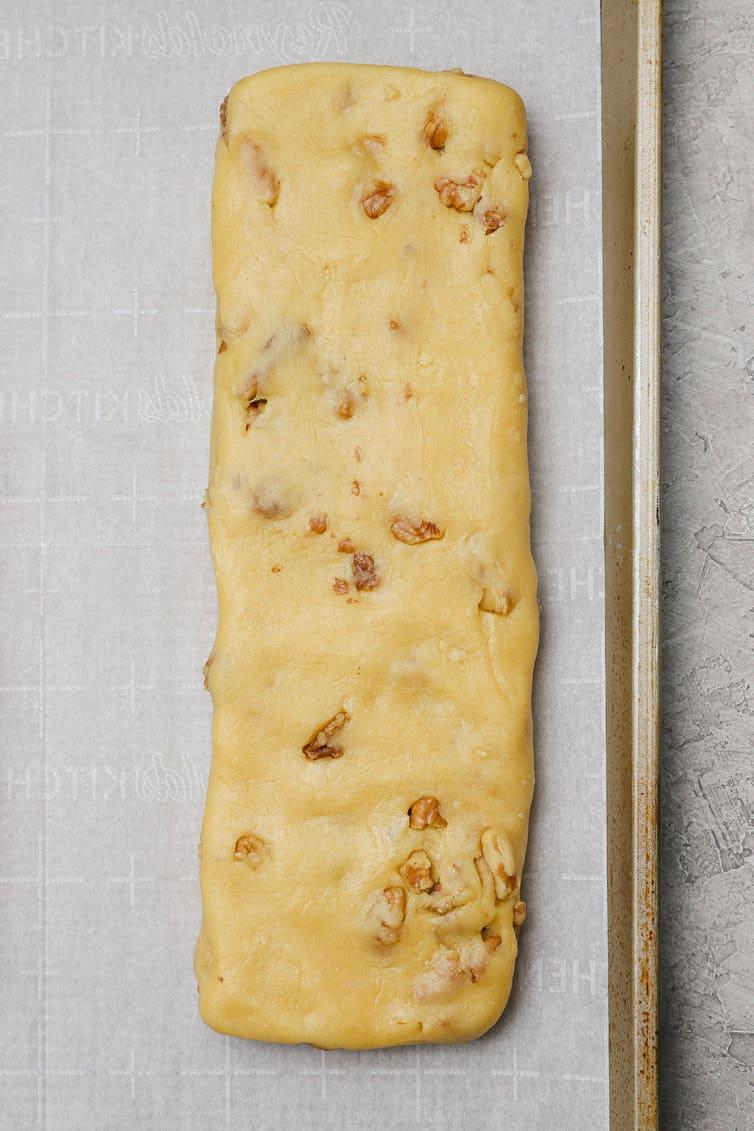 One log of biscotti dough on baking sheet.