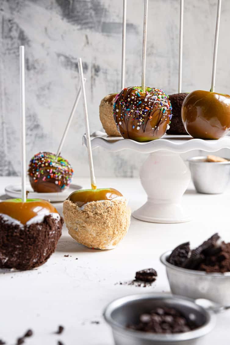 An assortment of decorated homemade caramel apples.