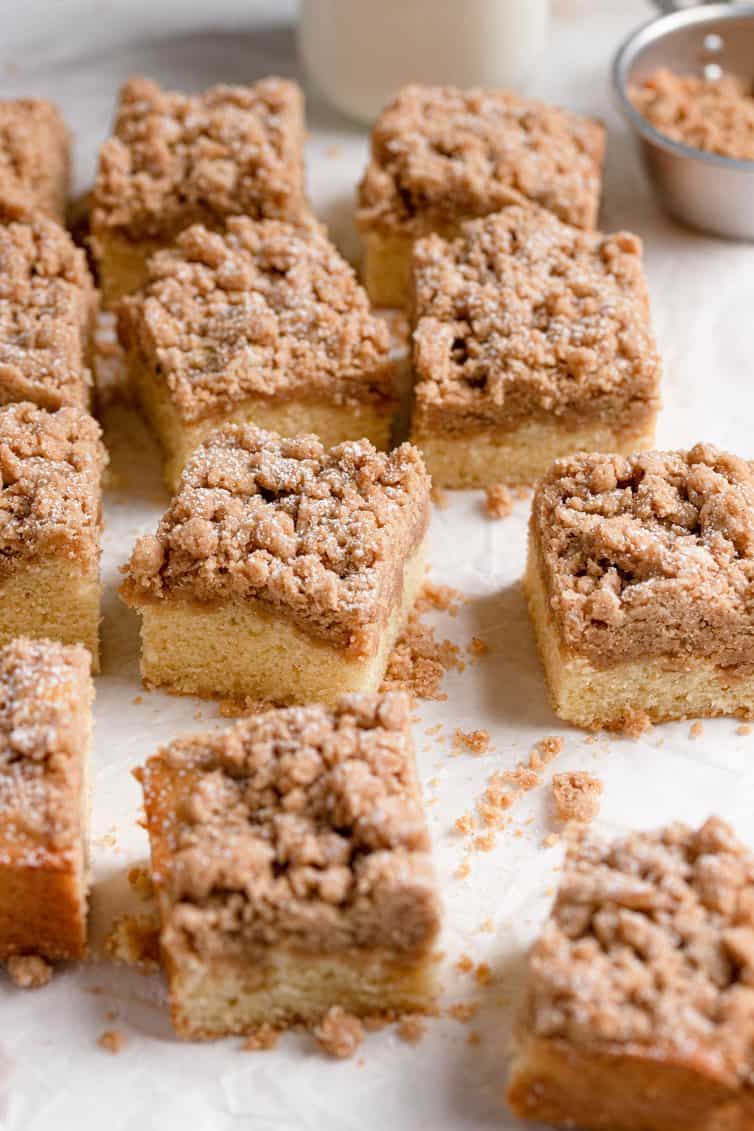 Squares of crumb cake on a cutting surface.