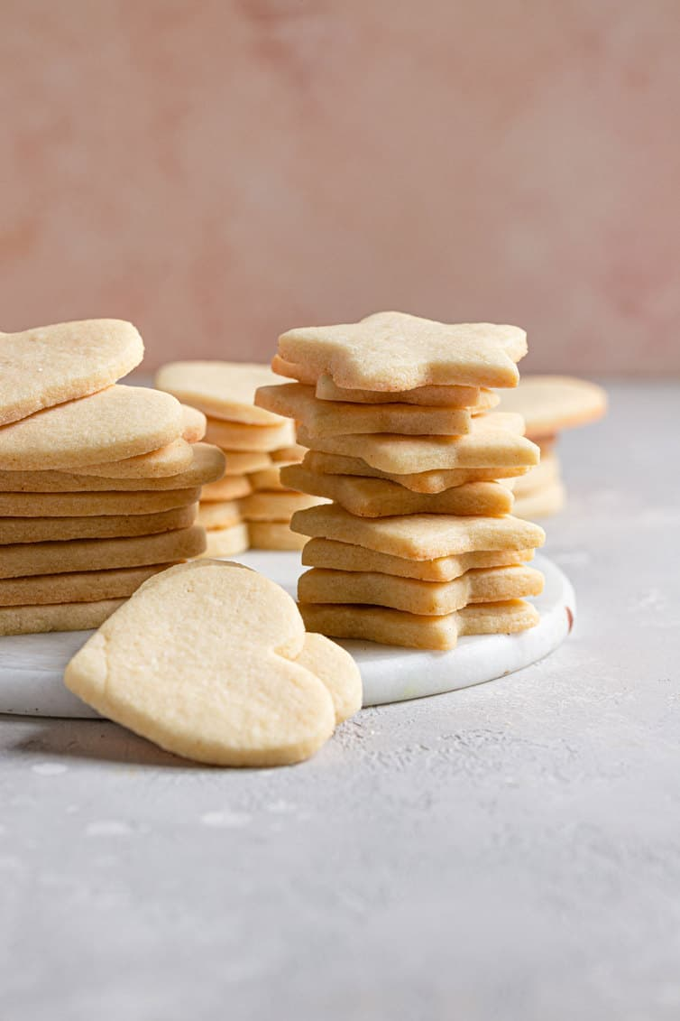 Stacks of heart and star shaped plain sugar cookies.
