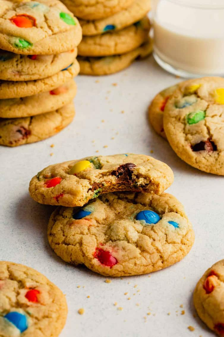 M&M cookies with one having a bite taken out.