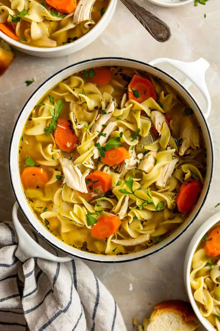 Overhead photo of chicken noodle soup in pot.
