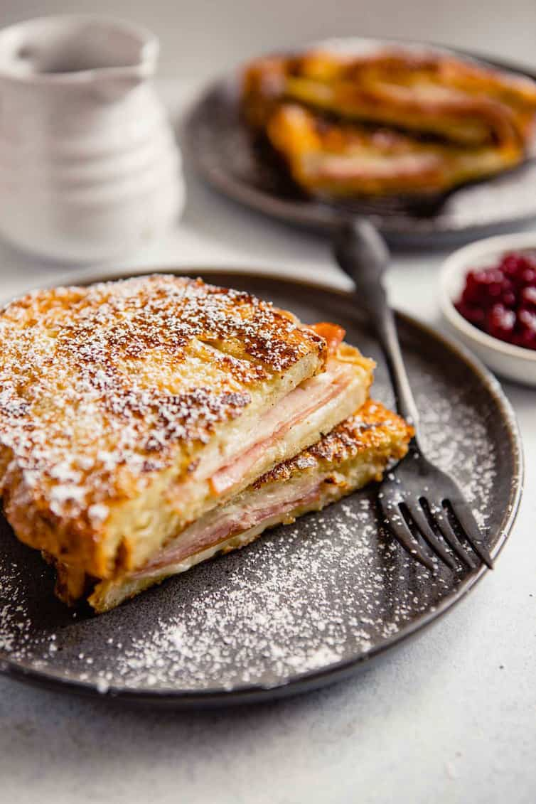 Monte Cristo sandwich on a plate with a fork.
