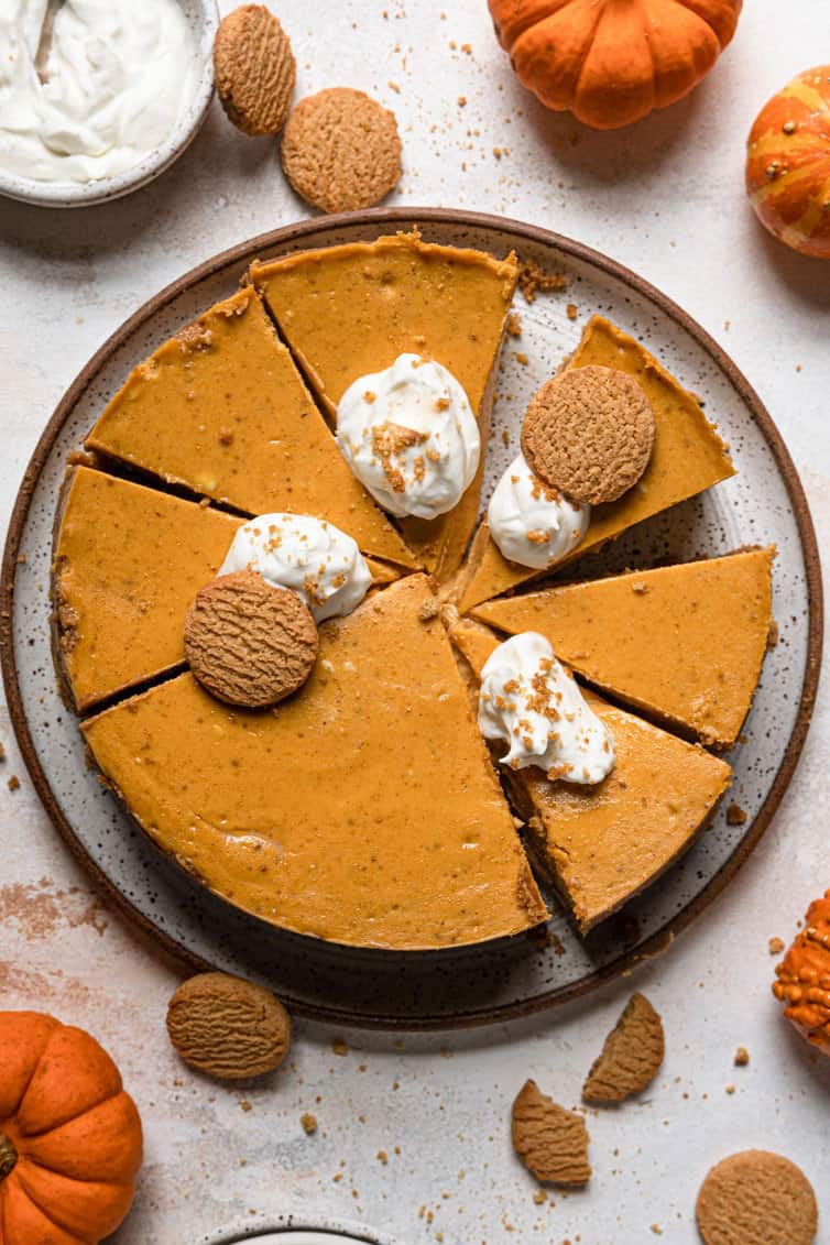 Overhead photo of pumpkin cheesecake sliced into individual pieces.