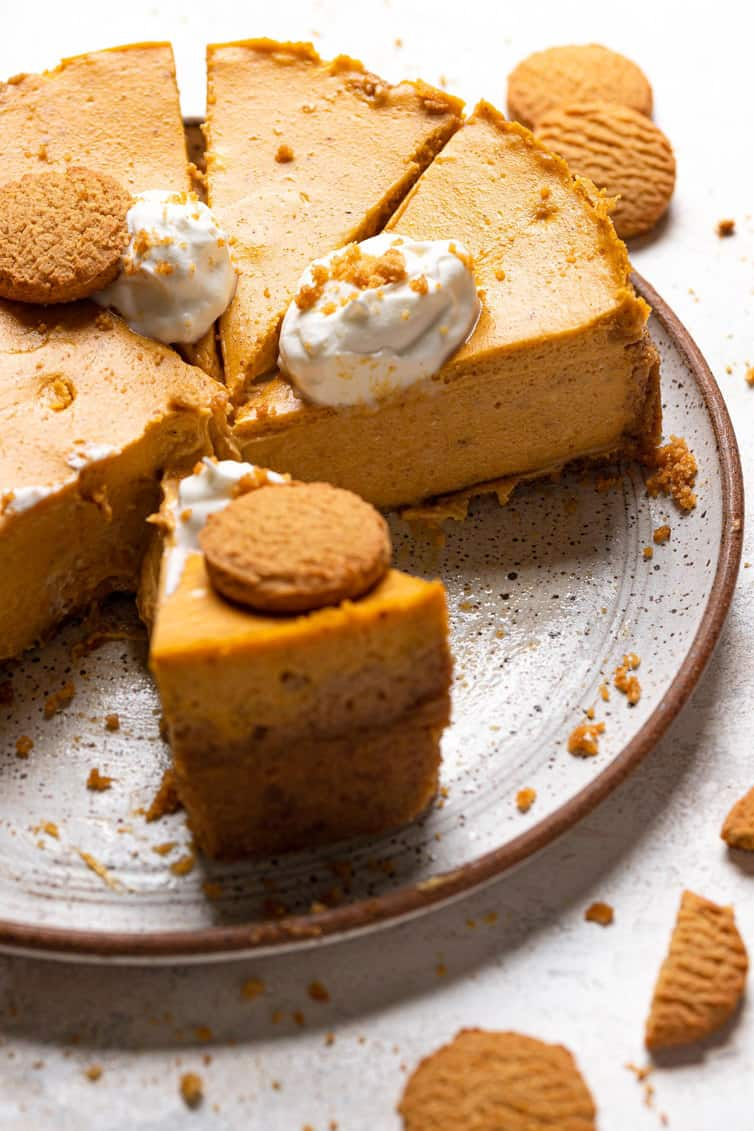 Slices of pumpkin cheesecake on the base of springform pan.