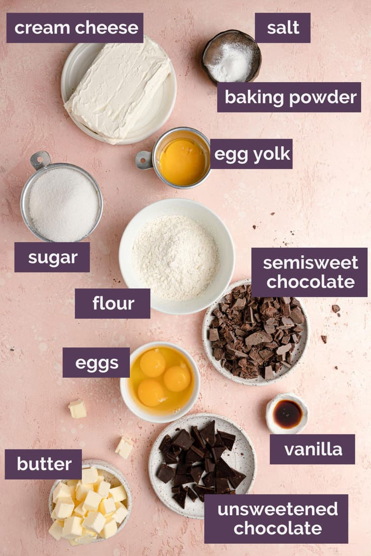 Ingredients for cheesecake brownies prepped and labeled.